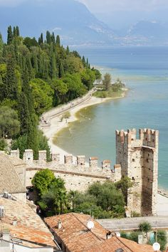 """Scaliger Castle, (Castello di Sirmione),  (13th century), Sirmione, Lake Garda, Brescia, Lombardy, Italy   Photo by mike-jess.com at: http://www.mike-jess.com/2013/03/scaliger-castle-sirmione.html?m=1   """"Place"""" address: Castello di Sirmione, Sirmione, Lombardia, Italia"""