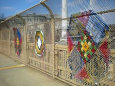 Hye Jin Lee, a student at Carnegie Mellon, has woven colorful patterns into the fence along the Junction Hollow Bridge in Oakland.