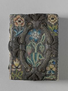 Book cover ca 1635, British, canvas worked with silk and metal thread, seed pearls; tent, Gobelin, and couching stitches
