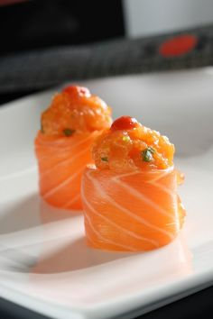 Sashimi Roll - good one for new year's eve. Fill with a crab meat tartar, with a dash of japanese mayo somewhere in the middle. If they are difficult to stay in place, a wrap of seaweed would work? Andre.