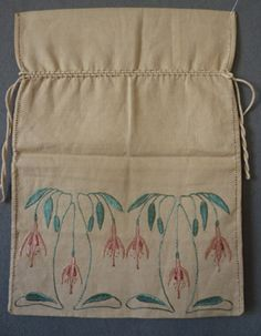 Glasgow School Bag c. 1900. Delightful piece. Probably used for holding embroidery silks. Probably sold at Liberty's, a work bag stylishly embroidered with fushias in shades of pink with blue green leaves, drawn threadwork to sides, corded drawstring top, natural linen ground, 15 x 11 in; 38 x28 cm. SOLD