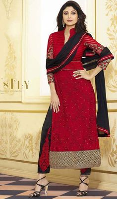 Letch a lasting impression in the minds of the onlookers similar like Shilpa Shetty as you are dolled up in this red embroidered net pant style suit. The ethnic butta, floral patch, lace, resham and stones work with a clothing adds a sign of attractiveness statement to your look. #SexyBlackReshamEmbroideredAnkleLengthSuit