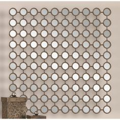 Small round designs are paired with beige frames to round out this Wall Mirror, a must-have addition to your decor collection. Its distinctive silhouette brings statement-making style to any space. Use it in the living room to round out a vibrant boho look or add it to the den to complement a minimalist aesthetic. Pair it with an abstract canvas print for a dynamic display or a patchwork rug for a pop of pattern. Hang it against a neutral wall to accentuate its bold design then match it with…