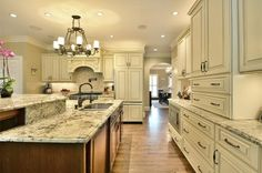 Traditional Kitchen with Limestone Tile, Alpine White Granite Countertop, Raised panel, Flush, Stone Tile, Kitchen island