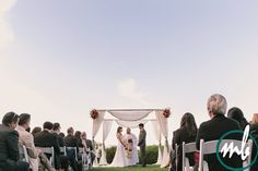 An amazing view of the couple and clear skies! Melissa Babasin Photography | Thomas fogarty winery