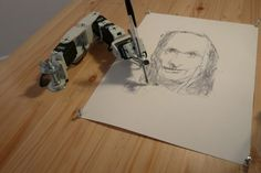 Paul is a sketching robot. These sketching robots are arms that illustrates people through its mechanical eye that looks around for a person, and when found, Paul focuses on that person and starts drawing.