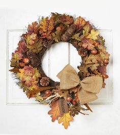 Kick start your seasonal decorations this fall with the Blooming Autumn 23 Oak, Acorn, Berry, Pinecone  and  Twig Wreath-Orange  and  Green. Bursting with oak leaves, acorns, pinecones, berry clusters