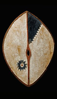 Africa | Old dance shield ~ ndome ~ from the Kikuyu people of Kenya | Wood and pigment