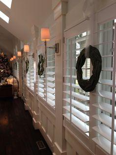 Plantation Shutters - love the wreaths