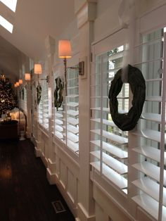 Plantation Shutters - love the sconces in between