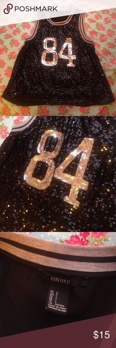 #84 Forever 21 sequined shirt Cute black #84 black tank top with black and gray sequins on the front. The back is a sheer material. In great condition, no tears or stains. Forever 21 Tops Tank Tops