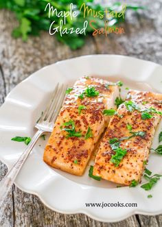 Maple Mustard Glazed Salmon - 4 ingredients turn this salmon into a super star. A healthy and delicious salmon, glazed with maple syrup and grainy mustard.