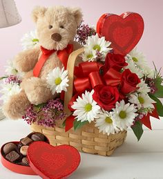 valentine flower in basket with teddy bear and heart shape chocolate