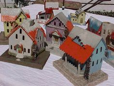 "1930 Made in Japan dimestore Christmas village houses called ""gloss tops,"" shellacked roofs with snow hand-painted over."