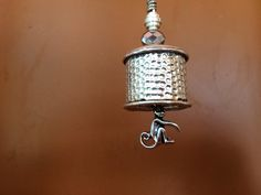 Unique and different silver dimpled motorcycle bike bell with monkey charm and silver accents by RealBeadDesigns on Etsy
