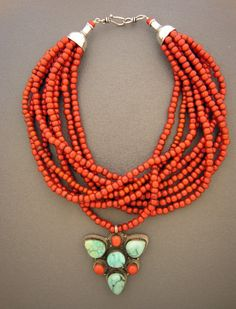 turquoise and coral amulet from Tibet, along with nine strands of small antique reddish orange whitehearts traded in Africa in the two silver cones, and a sterling silver hook and eye clasp which was handmade in Sri Lanka Tribal Jewelry, Turquoise Jewelry, Indian Jewelry, Beaded Jewelry, Silver Jewelry, Jewelry Necklaces, Handmade Jewelry, Beaded Necklace, Bracelets