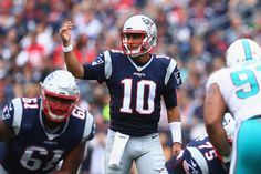 Jimmy Garoppolo Photos Photos - Jimmy Garoppolo #10 of the New England Patriots communicates at the line of scrimmage during the first half against the Miami Dolphins at Gillette Stadium on September 18, 2016 in Foxboro, Massachusetts. - Miami Dolphins v New England Patriots