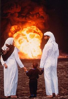 A  Kuwaiti family surveys the oil fields burned by retreating Iraqis