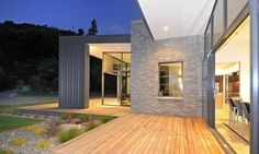 3-glass-cubed-volumes-sheltered-under-roof-sustainable-home-19-exterior.jpg