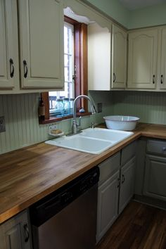 Kitchen idea - cabinets painted with chalk paint.  And I love the counter top!