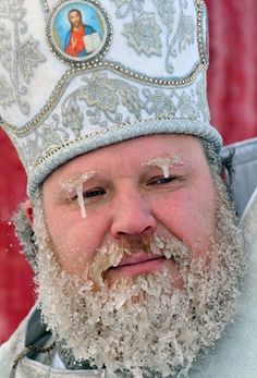 A Russian Bishop taking part in the Epiphany Baptismal rites. Believing that on this day water becomes holy and is imbued with special powers, Russians cut holes in the ice of lakes and rivers, often in the shape of the cross, to bathe in the freezing water. Participants in the ritual may dip themselves three times under the water, honoring the Holy Trinity, to symbolically wash away their sins from the past year, and to experience a sense of spiritual rebirth.