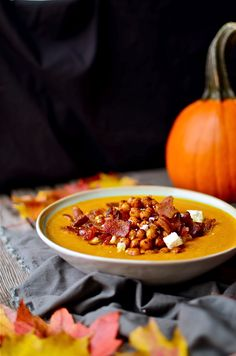 Creamy, spicy pumpkin soup with bacon, feta cheese, and crispy, spicy fried chickpeas. You can also use butternut squash or sweet potatoes!