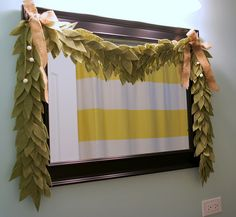 Felt Bay Leaf Garland « The Humble Nest- Could be done a LOT cheaper felt, with the balls and artificial flowers added to it. Could also make it thicker like the ends here.