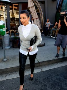 Kim : Love her outfit would look great with a pencil skirt or skinny jeans.