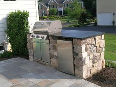 this outdoor kitchen is part of the outdoor living space in this patio design