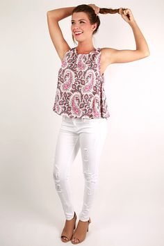 Nothing says dining in a cafe in Paris like this pretty paisley top! It's one of our favorite tanks yet this season! The neon details will brighten up any outfit! Pair it with white skinnies, a glam necklace, and comfy wedges, then enjoy Europe in effortlessly chic style!