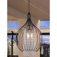 Highlight your dining room tableware and delicious meals at your next dinner party with this elegant Kate crystal chandelier from Warehouse of Tiffany. With its multi-directional lighting direction il