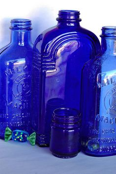 Old Cobalt Blue Bottles Including Vicks & Milk of Magnesia Blue Glass Bottles, Cobalt Glass, Blue Bottle, Antique Bottles, Vintage Bottles, Bottles And Jars, Antique Glass, Glass Jars, Cobalt Blue