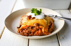 Mexican seasoned shredded beef enchiladas with melted cheese, corn tortillas, and homemade enchilada sauce. An easy beef enchilada casserole! Enchilada Casserole Beef, Homemade Enchilada Sauce, Homemade Enchiladas, Red Enchilada Sauce, Mexican Food Dishes, Mexican Food Restaurants, Mexican Food Recipes, Main Dishes, Ratatouille