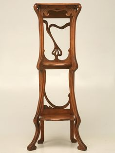 Unbelievable circa 1890 hand-carved French walnut Art Nouveau etagere, Graceful and flowing lines are what set Art Nouveau style apart from any other. Description from 1stdibs.com. I searched for this on bing.com/images