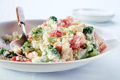 Rotini pasta, broccoli, carrots, tomatoes, green onions and cottage cheese are tossed with ranch dressing in this colorful and easy 15-minute salad.