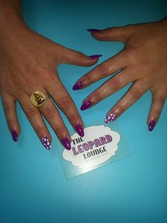 Purle gel nails with leopard print. Looks cool!