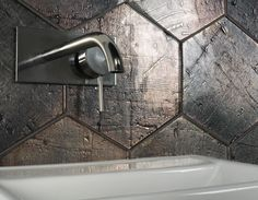 This urban industrial looking hexagonal glass wall tile is durable and versatile and can be used to create a beautiful feature wall. Supplied by Exto