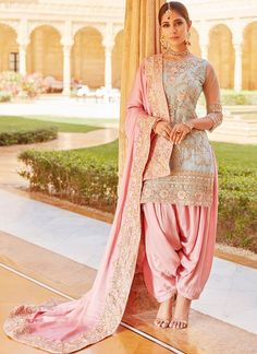 Mint and Pink Embroidered Punjabi Suit Mint and Pink Embroidered Punjabi Suit features a net kameez with santoon inner, santoon bottom and satin dupatta. Embroidery work is completed with laces, thread and zari embellishments on this style. Indian Suits Punjabi, Punjabi Suits Party Wear, Punjabi Salwar Suits, Punjabi Dress, Indian Wear, Punjabi Wedding Suit, New Punjabi Suit, White Punjabi Suits, Latest Punjabi Suits