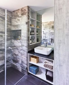 House Tour: A luxe, open condominium apartment in Siglap with an unusual layout - Home & Decor Singapore Ensuite Bathrooms, Master Bathroom, Accordian Door, Stone Look Tile, Create Space, Condominium, House Tours, Singapore, Toilet