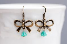 So dainty, darling, and timelessly pretty. #earrings #bows #turquoise #brass #jewelry