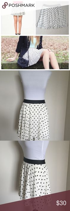 Express Minus the Leather High Waist Mini Skirt (MINUS THE) Leather High Waist Trimmed Mini Skirt. White w black polka dots & faux leather trim at waist mini skirt. I absolutely love this skirt & have only worn a couple of times. Selling bc I'm cleaning out my closet. There is 1 small snag on the front, shown in last collage picture (circled), not super noticeable bc of the breeziness of the skirt. Other than that it is in excellent used condition. Zip closure in the back with an eyelot…