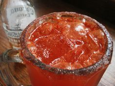 Michelada - Mexican beer cocktail.  Clamato, taijin, limones, sal, salsa de ingles, Beer! with a spiced rim.