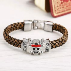 Now available on our store : ONE PIECE Mugiwar...   SHOP HERE : http://pica-collection.com/products/one-piece-mugiwara-pirates-emblem-bracelet?utm_campaign=social_autopilot&utm_source=pin&utm_medium=pin