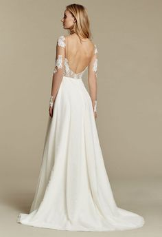 """""""Ginger"""" gown. Ivory long sleeve lace A-line bridal gown, illusion bateau neckline with sweetheart lining and low open back, circular skirt of layered English net and organza."""