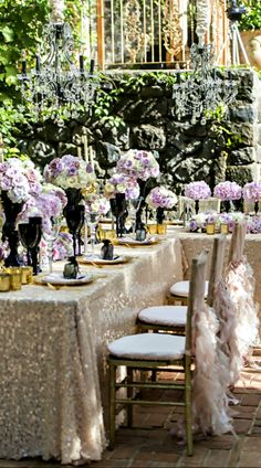 Gorgeous glam wedding table inspiration with sparkling linens and ruffled chair backs #wedding #reception #tables