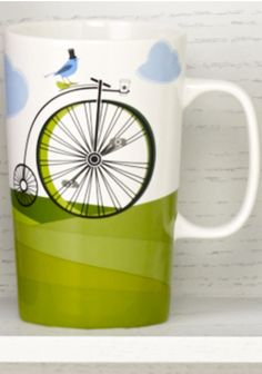Ceramic coffee mug featuring a penny-farthing bike with a coffee cup holder. #Starbucks #DotCollection