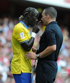 Bacary Sagna of Arsenal ---has a word with Referee Kevin Friend during the Emirates Cup match between Arsenal and Napoli at the Emirates Stadium on August , 2013