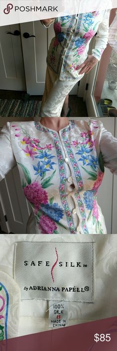"""Easter outfit 100% silk jacket and skirt 8 An impression of Chanel-like blossoms on cream color silk, with blue and purple lilacs on both the front and back of the jacket, and the sleeves.  Excellent condition!  Fully lined.  Dry clean only.  Jacket is 27"""" top to bottom; 20"""" arm pit to arm pit; 16.5"""" arm pit to end of sleeve; 23"""" shoulder seam to end of sleeve; 5"""" neckline to shoulder seam.  Padded shoulders.  Skirt 26"""" top to bottom; 13"""" across elastic waistline; 19"""" across the hips…"""