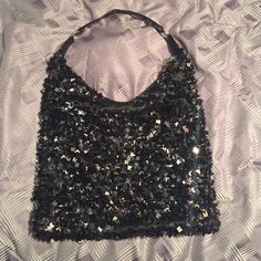 Black sequence bag! Little bit of wear and tear as shown in pictures, but still cute and shiny! Sequence are square! Small phone pocket and zip pocket on inside! Zips up! No stains! Nicole Lee Bags Shoulder Bags
