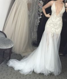 This sexy wedding dress has a deep v-neck line that can be adjusted. The beading on this is also very beautiful.  We can replicate haute couture wedding dresses to look very similar to the original but cost way less.  os for the brides on a tighter budget this is a great option.  You can have teh same type of style & look but in a price range that matches your budget.  For more information on custom #weddingdresses or #inspireddesigns please visit our main website at www.dariuscordell.com